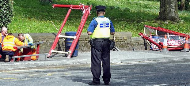 Police at the scene of the crash in Keighley Road, Bradford
