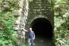 Saltaire historian David King stands by a ventilation shaft of the Richland Mine in Tennessee