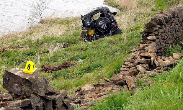 The Land Rover after it crashed through the wall and into Chelker Reservoir