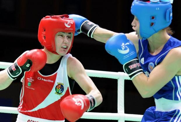 Lightweight Katie Taylor, left, on her way to the gold medal against Russia's Sofya Ochigava