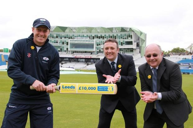 From left, Yorkshire cricket captain Andrew Gale wielding the special cricket bat, Gary Brook from Leeds Building Society and Brian Curran of Marie Curie Cancer Care at Headingley Carnegie Stadium