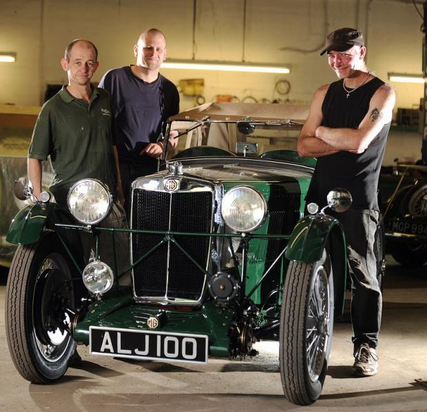 Craig Smith, Craig Dixon and Michael Ridyard with the car