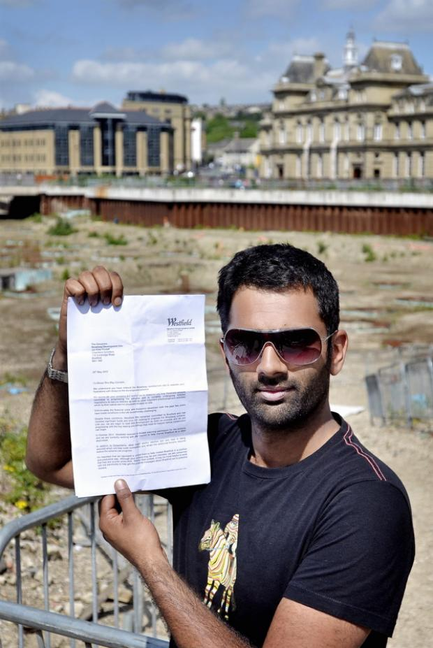 Occupy Westfield's 'Mr V' pictured on site with the letter they have received from Westfield