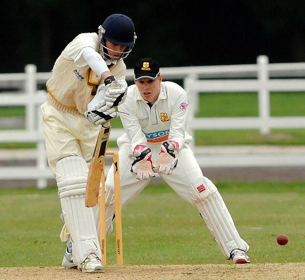 Pudsey's Jordan Thompson is in watchful mood as Bradford & Bingley wicketkeeper Matthew Duce looks on