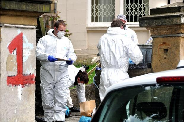 Forensic officers at the Apsley Crescent scene