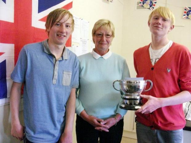 Bradford Junior Handicap winner Matthew Jacques, right, with twin brother Chris and Joan Law, secretary of host club Queensbury