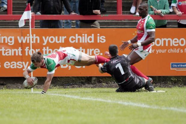 James Haythornthwaite dives over to score the first of the Cougars' four tries in a losing cause