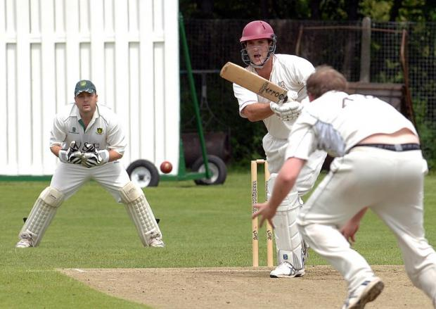 Woodlands' Simon Mason escapes being caught and bowled by Wrenthorpe's Greig Batty