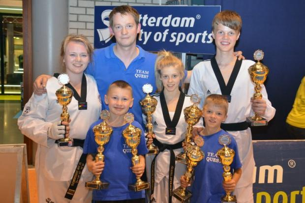 Quest Taekwondo members with their haul of medals from Holland