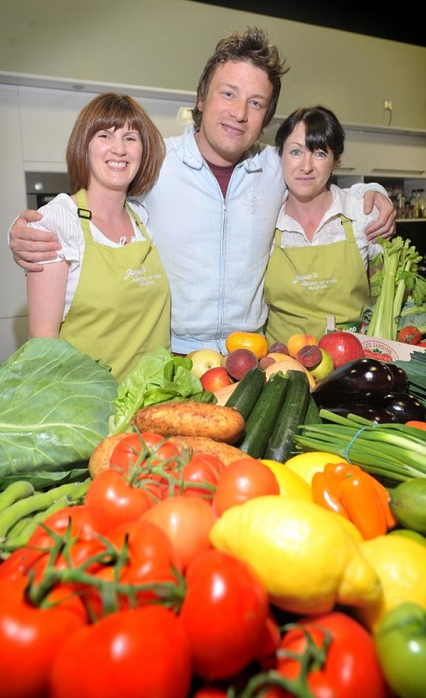 PUKKA: Jamie Oliver, with Lisa McLoughlin and manager Soraya Overend, on a recent visit to his Ministry of Food centre in Bradford