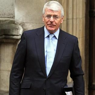 Former prime minister Sir John Major arrives at the Royal Courts of Justice to attend the Leveson Inquiry into press standards