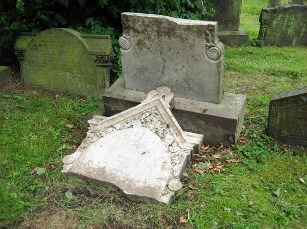 A damaged gravestone in the cemetery