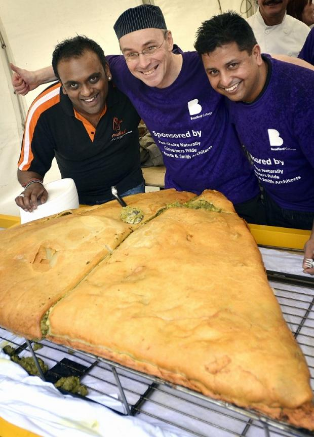 Bradford Telegraph and Argus: TASTY: The world record was broken for the largest samosa at the Positive Bradford event in Centenary Square