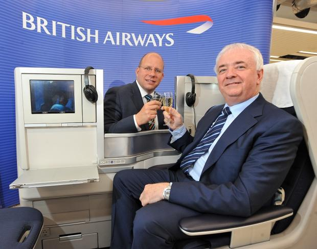 Celebrating with one of British Airways' premium beds are Andy Lord, director of operations for British Airways, and John Parkin, Leeds Bradford Airport CEO