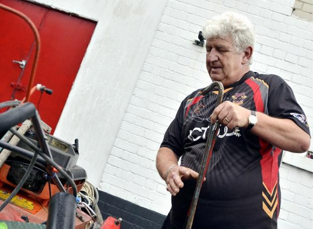 Bradford Bulls Stadium Maintenance Officer, Sergio Negre, packs up equipment at Odsal