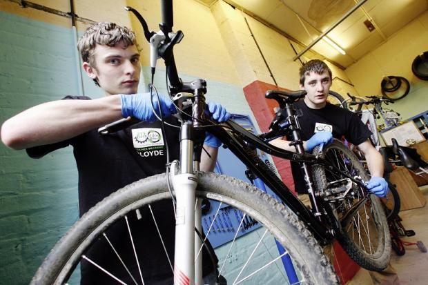 Trainee mechanics James Lloyd (left) and Trevor Rooney at work on one of the machines at Barnardo's Bikes