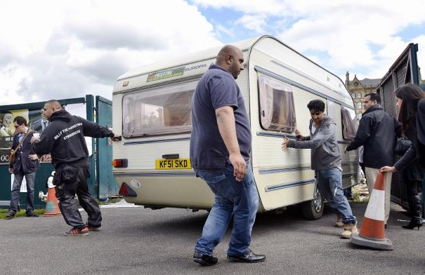 The protestors moving their caravns off the Westfield site earlier today