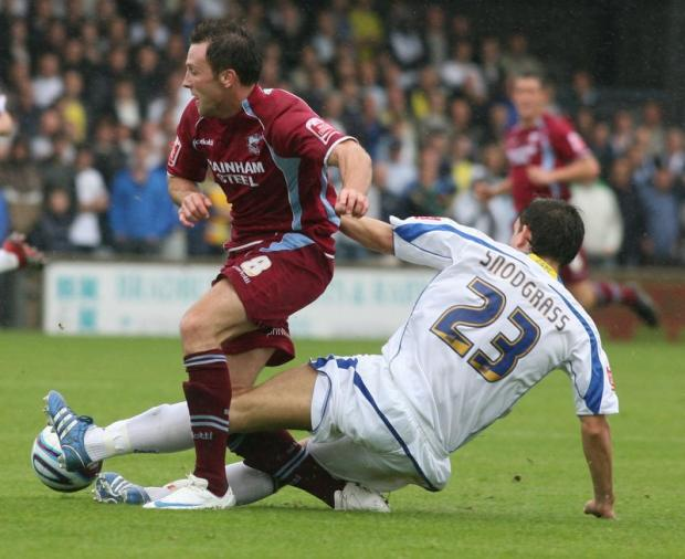 Garry Thompson, being tackled by Leeds United's Robert Snodgrass, has become Bradford City's sixth signing of the summer