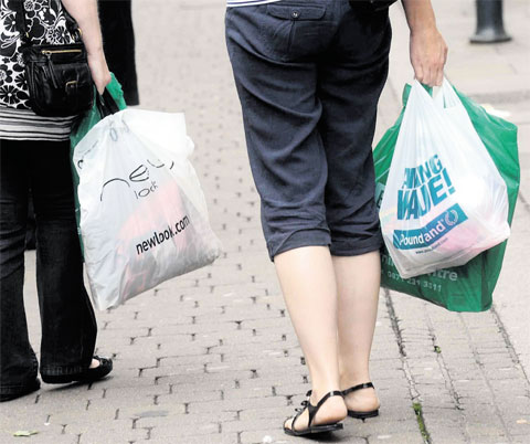 A small 5p charge is to be introduced on carrier bags from next October