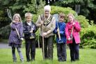 Eight-year-olds Mollie Reeve, Jack Evans, Thomas Pearson and Emily Ettenfield are pictured with Anne Jay