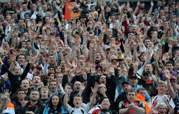 Passionate Bulls fans cheer their team during the weekend home game against London Broncos
