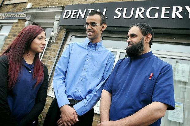 Rangzab Bashir, centre, visiting his brother, dentist Dr Shabir Bashir (right) and dental nurse, Uznah Chowdrey