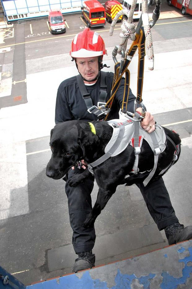 Firefighter Nigel Gill with Eddie the dog