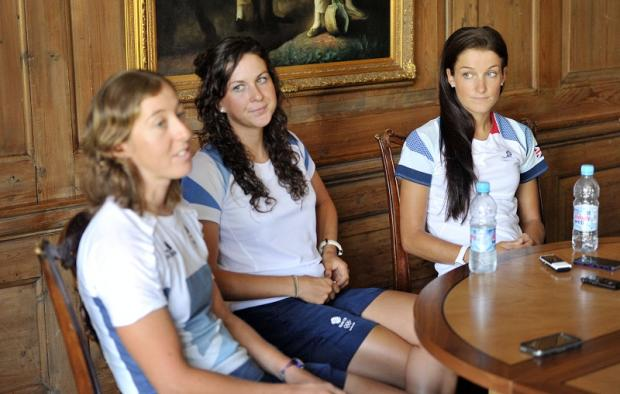 Lizzie Armitstead, right, relaxes with her team-mates before Sunday's race