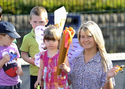 Bells are rung at Kiddi-Creche Nursery in Cottingley to celebrate the start of the Olympics