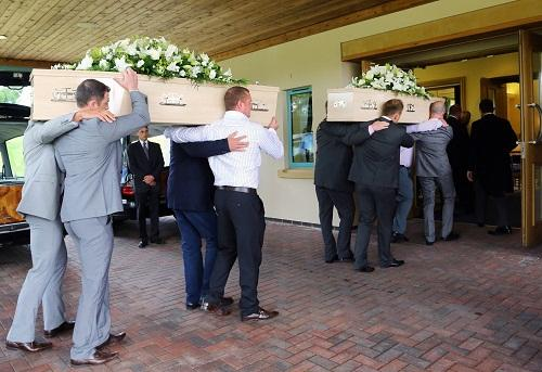 DEVOTED: The coffins of Mark and Tamsie Mchale arrive at yesterday's funeral service