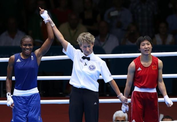 Nicola Adams shows her delight after getting the gold medal verdict over China's Ren Cancan
