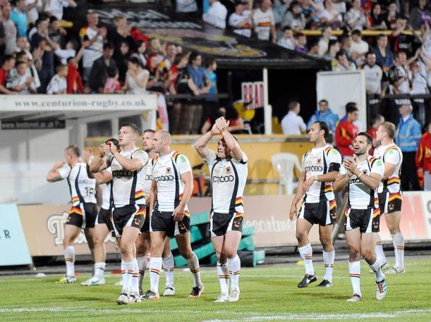 Bulls players applaud the Odsal fans after their victory over Hull KR