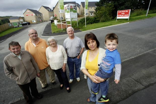 action group members gather at the housing development site off North Dean Avenue, from left, Ashley Forsyth, David Archer, June Newell, Malcolm Balmforth, Barbara Archer and Daniel Dunn