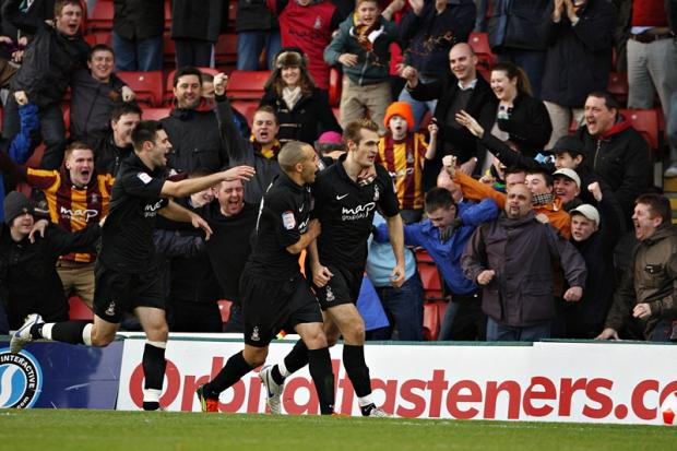 James Hanson celebrates equalising for City at Watford in the FA Cup third round last season