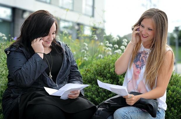 Laura Oxley and Danielle Robinson phone home with their A-level results at Tong High School