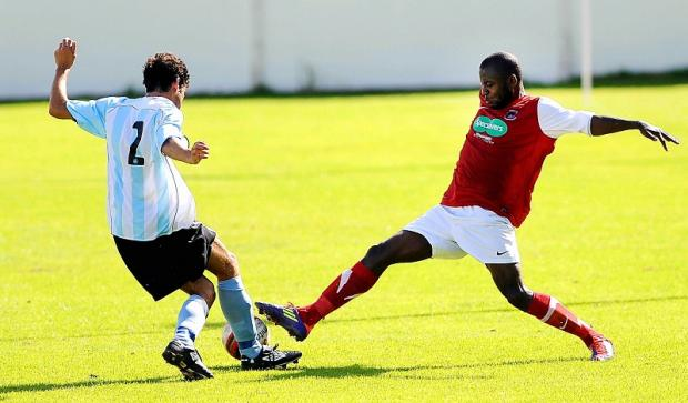 Thackley's Brice Tiani, right, tries to win the ball in a challenge with Barton's Alex Sherwood