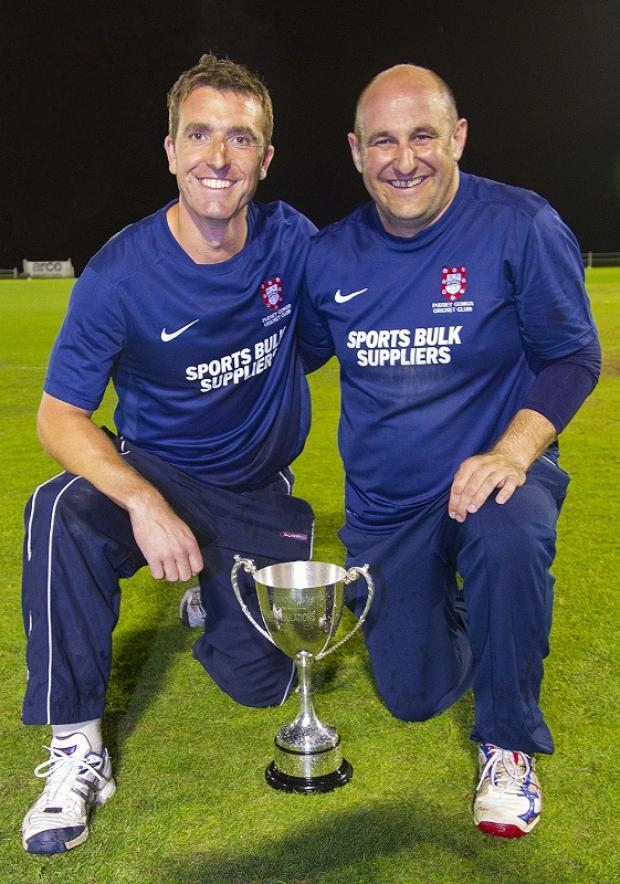 Skipper Glenn Roberts, left, and former captain Andy Bairstow are all smiles after Pudsey Congs won the Dyson Insulations Twenty20 Cup. Picture: JCT600 Bradford League