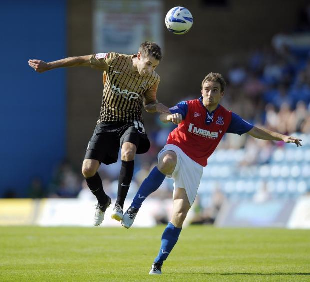 Gary Jones, Rory McArdle and Will Atkinson, pictured, were all Rochdale players the last time City went to Spotland in 2010