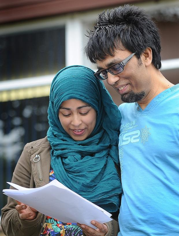 Saarah Islam showing her GCSE results to her dad, Naz Islam, at Samuel Lister College