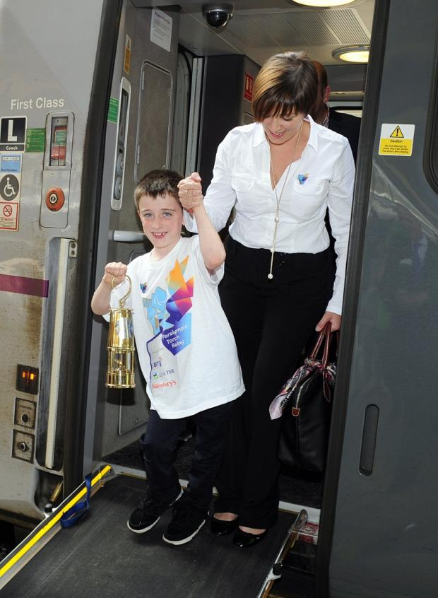 Lynda Whitton and son Evan in London with the Paralympic Flame