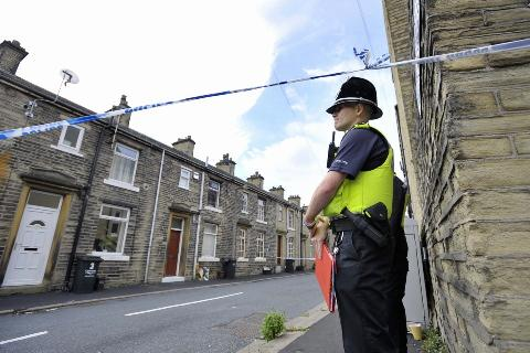 A police officer mans a cordon in South Street, Brighouse