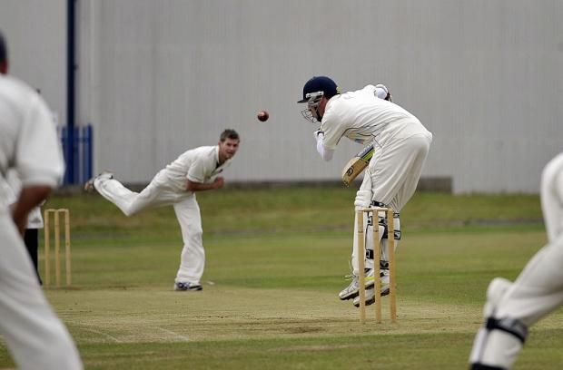WICKET FLURRY: Cleckheaton bowler James Lee claimed 4-28 as his side snatched victory at Manningham Mills