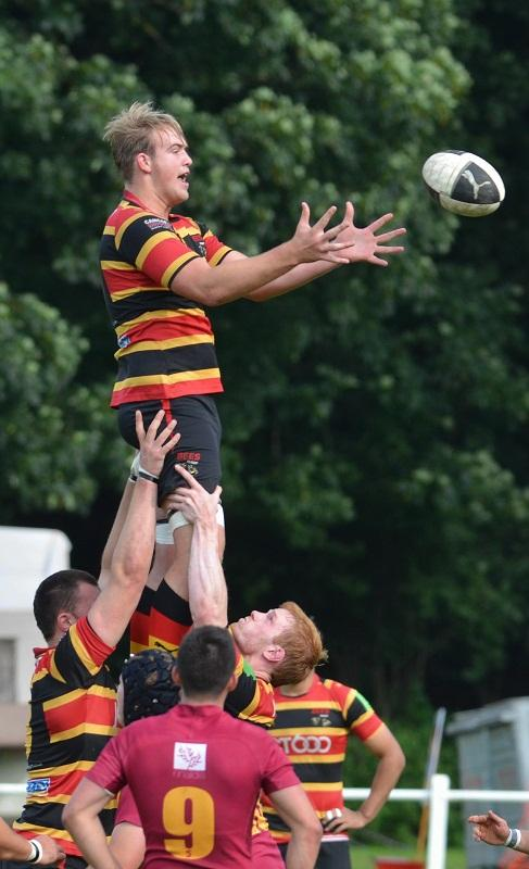 Bradford and Bingley's Brett Mitchell climbs high in a lineout