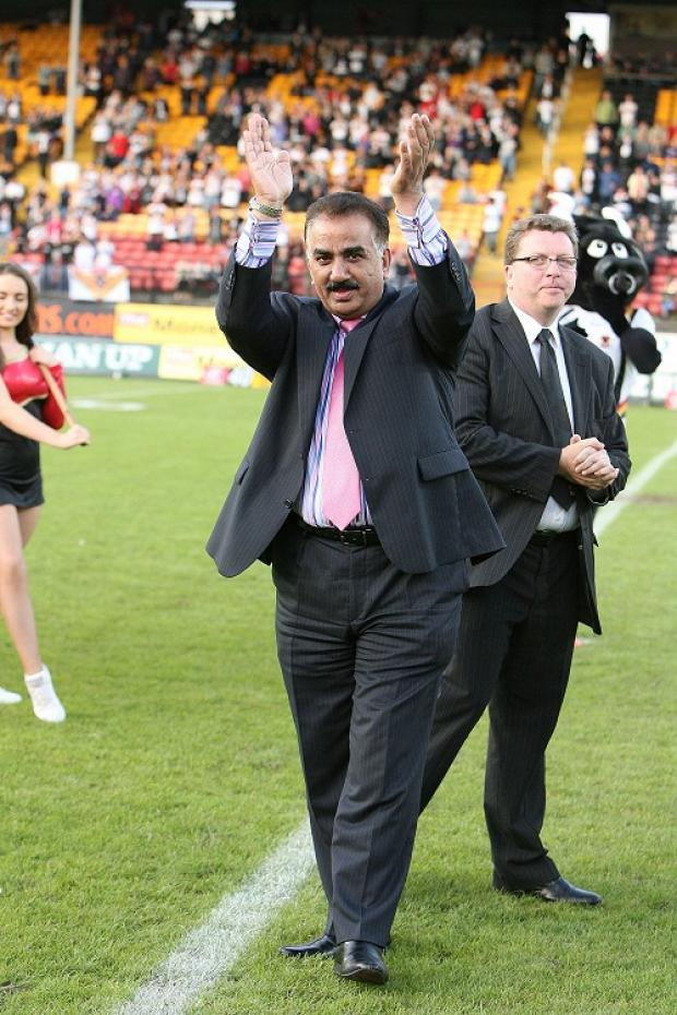Omar Khan and Gerry Sutcliffe, new owners of the Bradford Bulls, on the pitch before the match against Hull