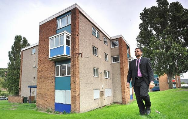 Councillor Rizwan Malik at the flats in Shipley which will be demolished