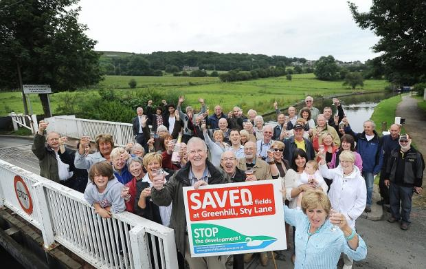 Protesters in Micklethwaite celebrate as plans for building work are thrown out by a government inspector