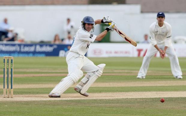 Andrew Hodd scored a half-century and took five first-innings catches on his Yorkshire debut against Derbyshire