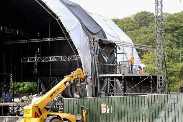 Workers start to dismantle the main stage