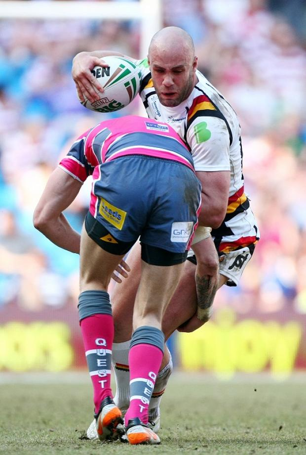 Adrian Purtell runs into Leeds opponent Zak Hardaker during the Magic Weekend match in Manchester