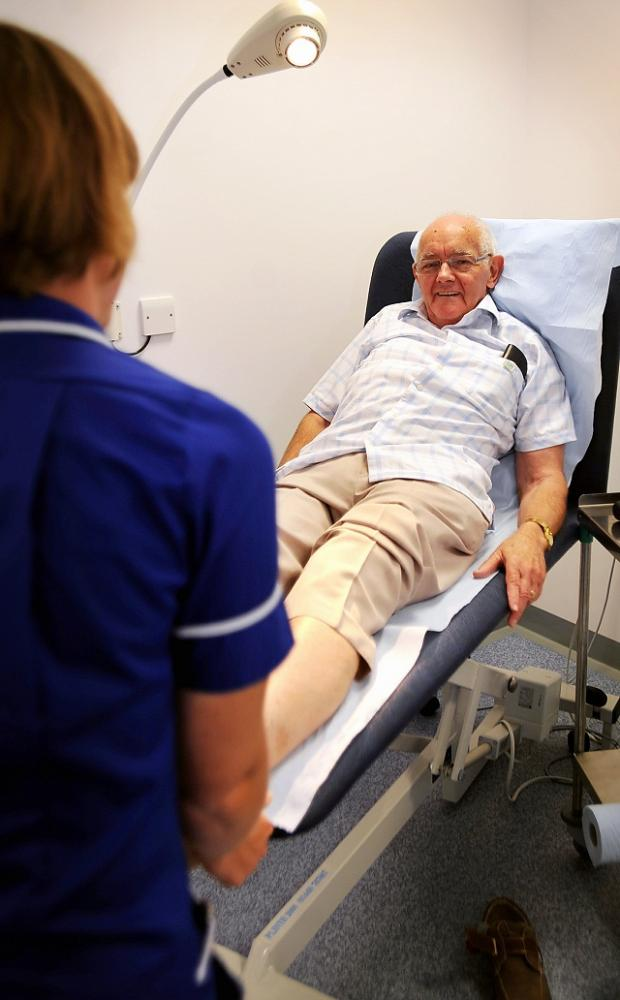 Lymphoedema support group chairman Paul Deary is treated at Undercliffe medical centre by a nurse